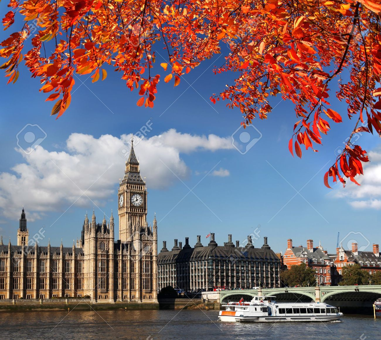 Big Ben with autumn leaves in London, England - 16325278