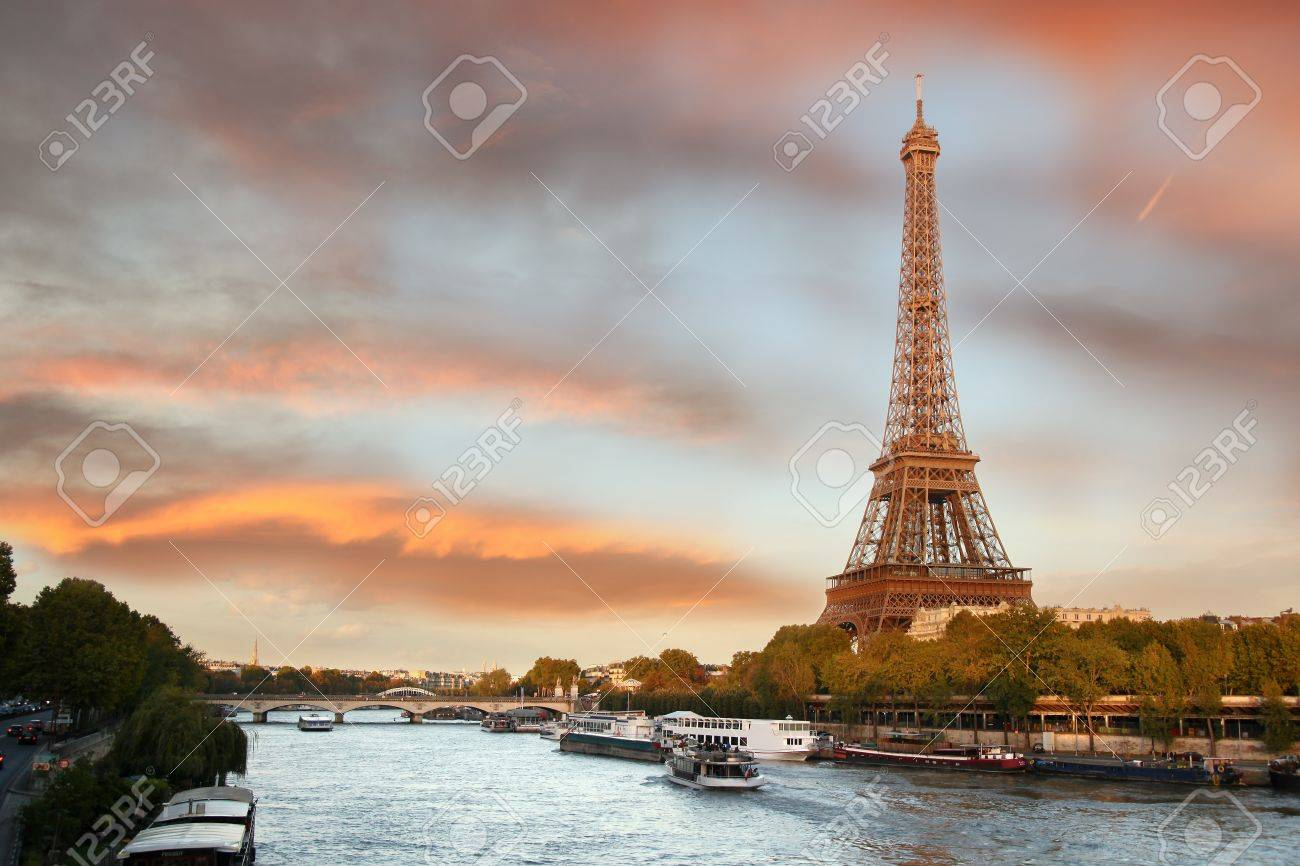Eiffel Tower with boats in evening Paris, France - 16729839