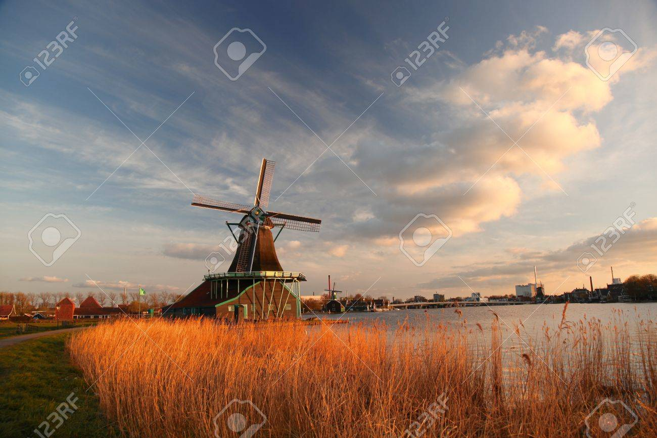 Traditional Dutch windmills with canal against sunset in Amsterdam area, Holland Stock Photo - 19891484
