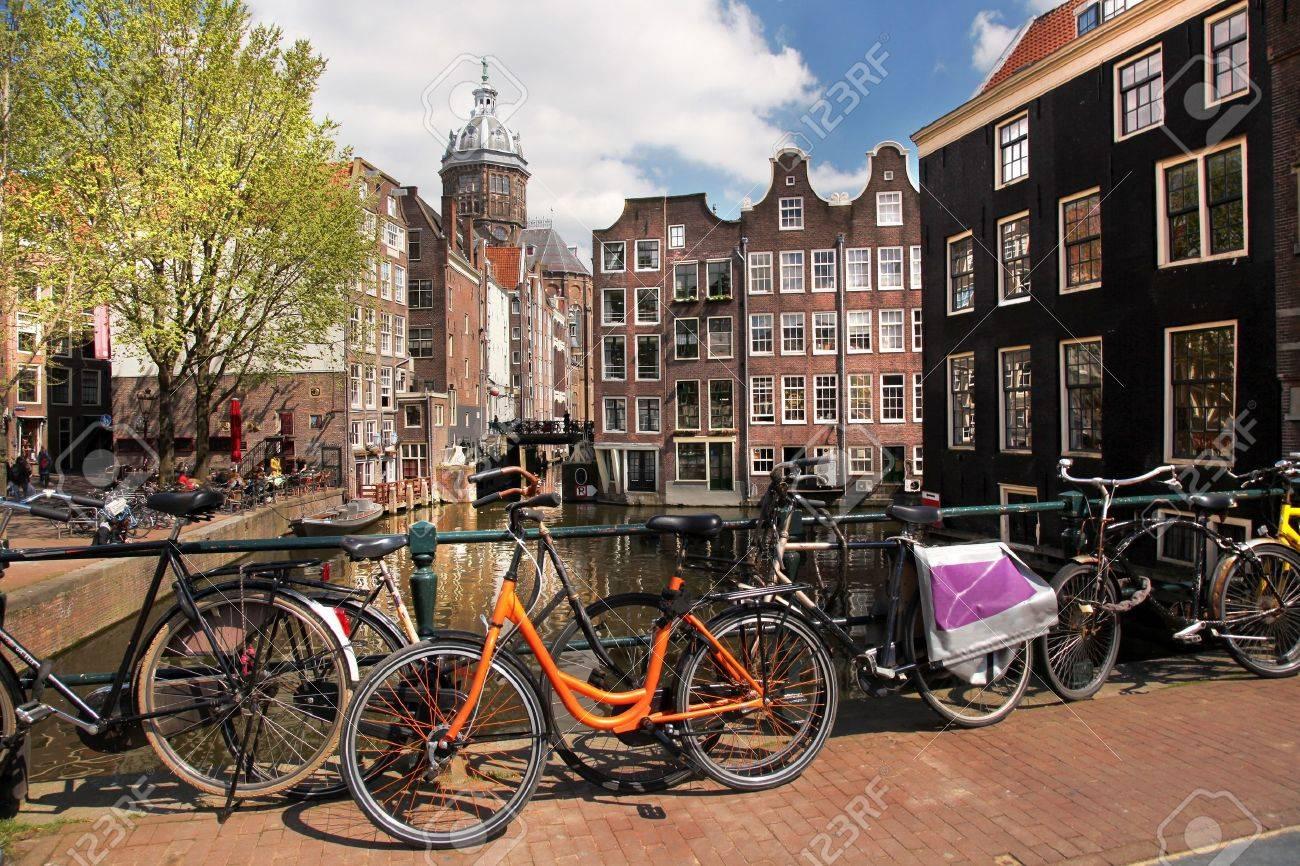 Amsterdam with bikes on the bridge, Holland - 20183799