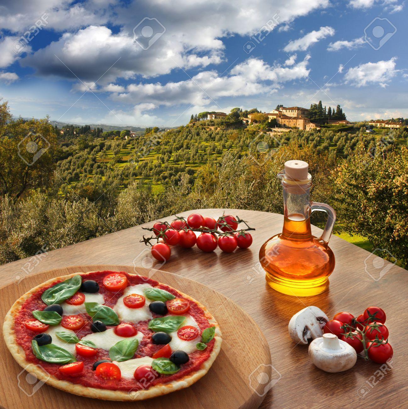 Italian pizza in Chianti, famous vineyard landscape in Italy - 21483125