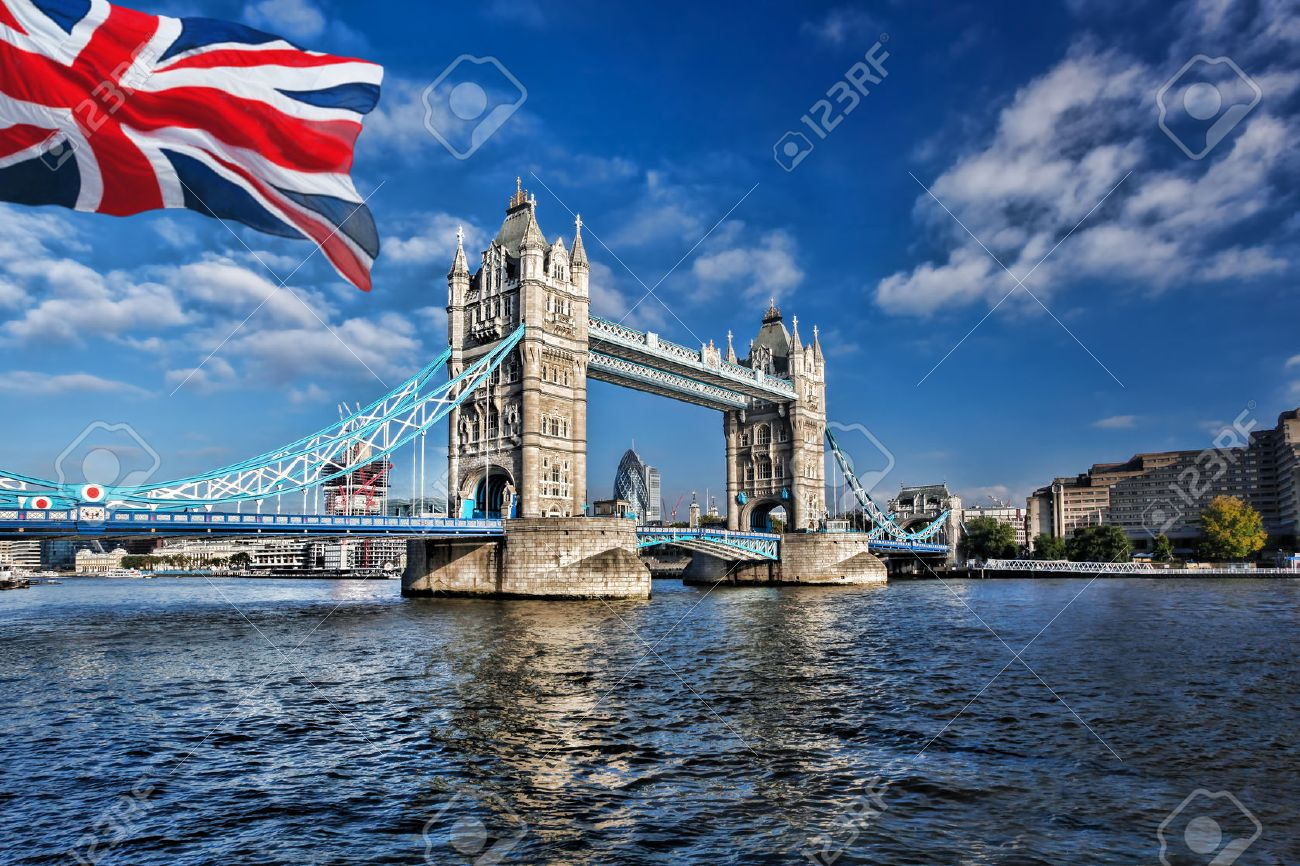 Famous Tower Bridge with flag of England in London, UK - 43879817