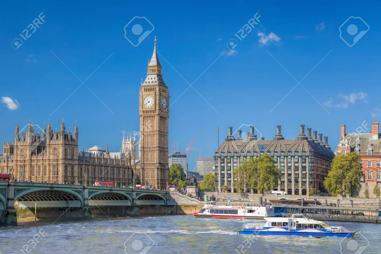 Big Ben and Houses of Parliament with boats on the river in London, England, UK - 141121445