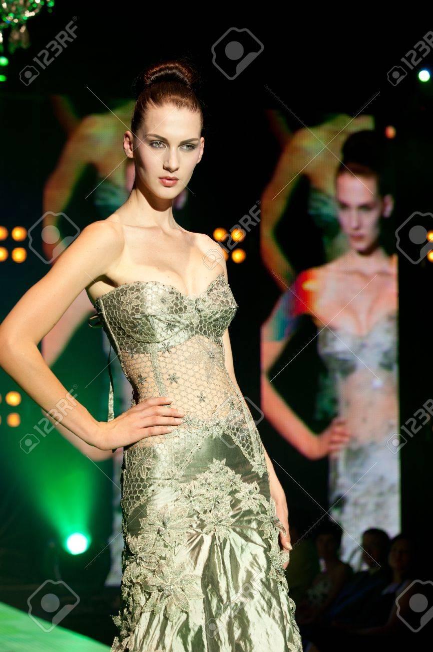 IDRIJA, SLOVENIA - JUN 18: Model Nika Mihelcic in Urska Drofenik creation with idria lace on fashion show at Idrija lace festival In Idrija on June 18. The festival was held 17th to 20th June 2011 Stock Photo - 9777136