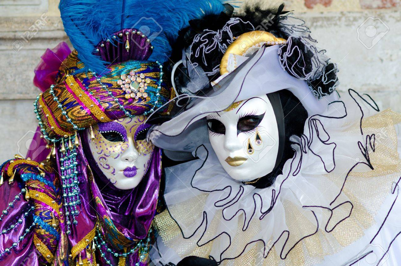 VENICE, ITALY - MARCH 7: An unidentified masked couple pose in front of St. Mark church in Venice, during the annual Venice carnival. The carnival is from February 26 - March 8, 2011.  Stock Photo - 10006615