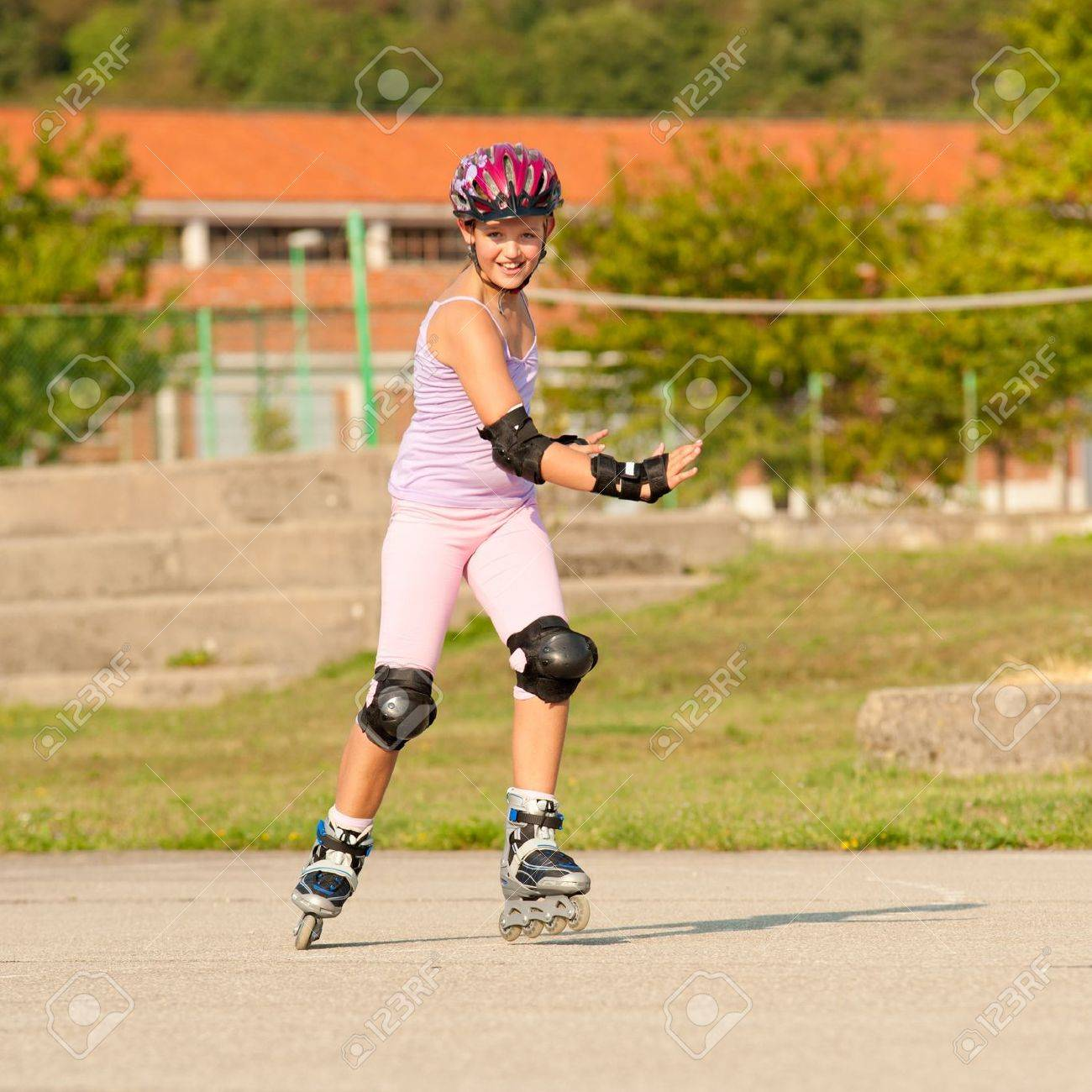 Cute young girl rollerskates on a playground Stock Photo - 11082927