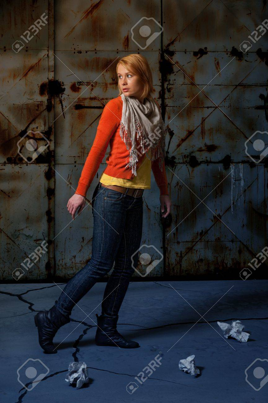 frightened Lone girl walking the street at night Stock Photo - 11682364
