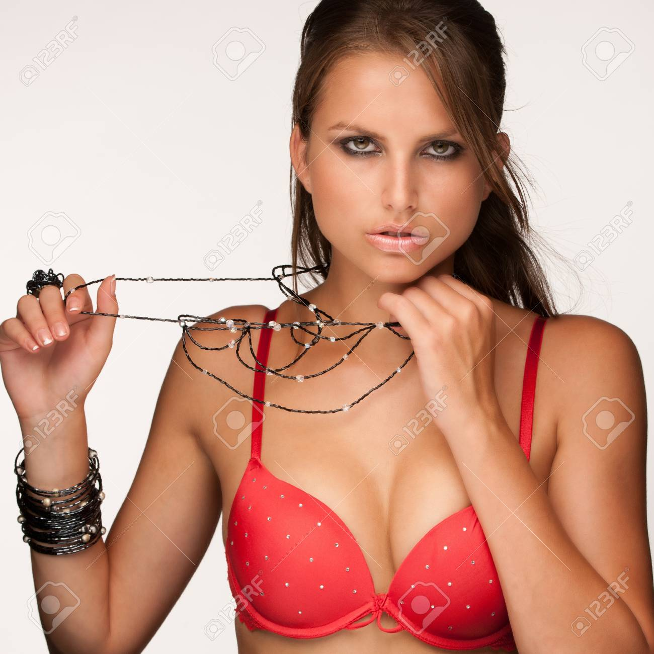 Beautiful young model in red underwear with jewelery Stock Photo - 15288707