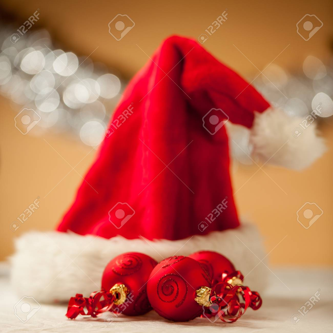 Christmas ornaments - red baubles with shiny tape in background - 16413443
