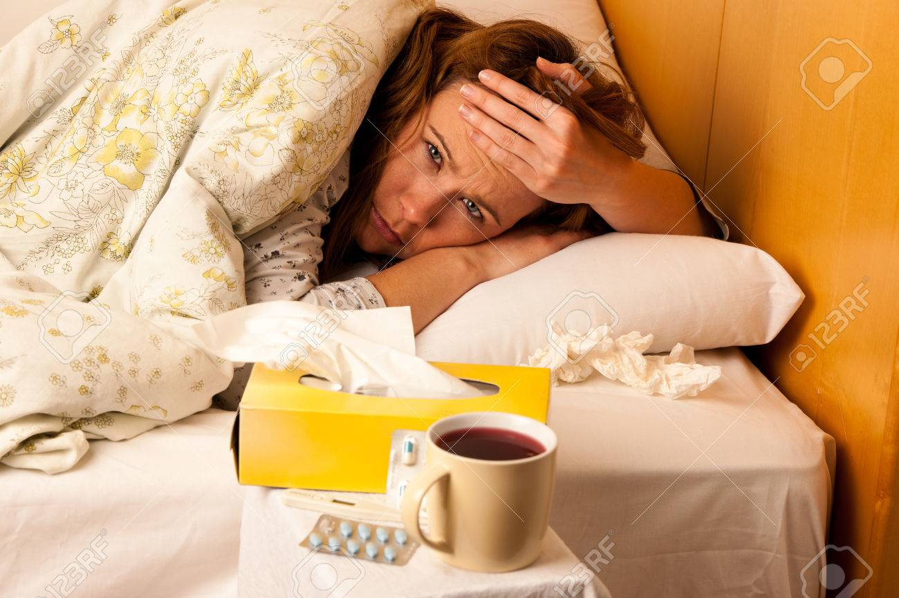 Sick young woman resting in bed Stock Photo - 25246627