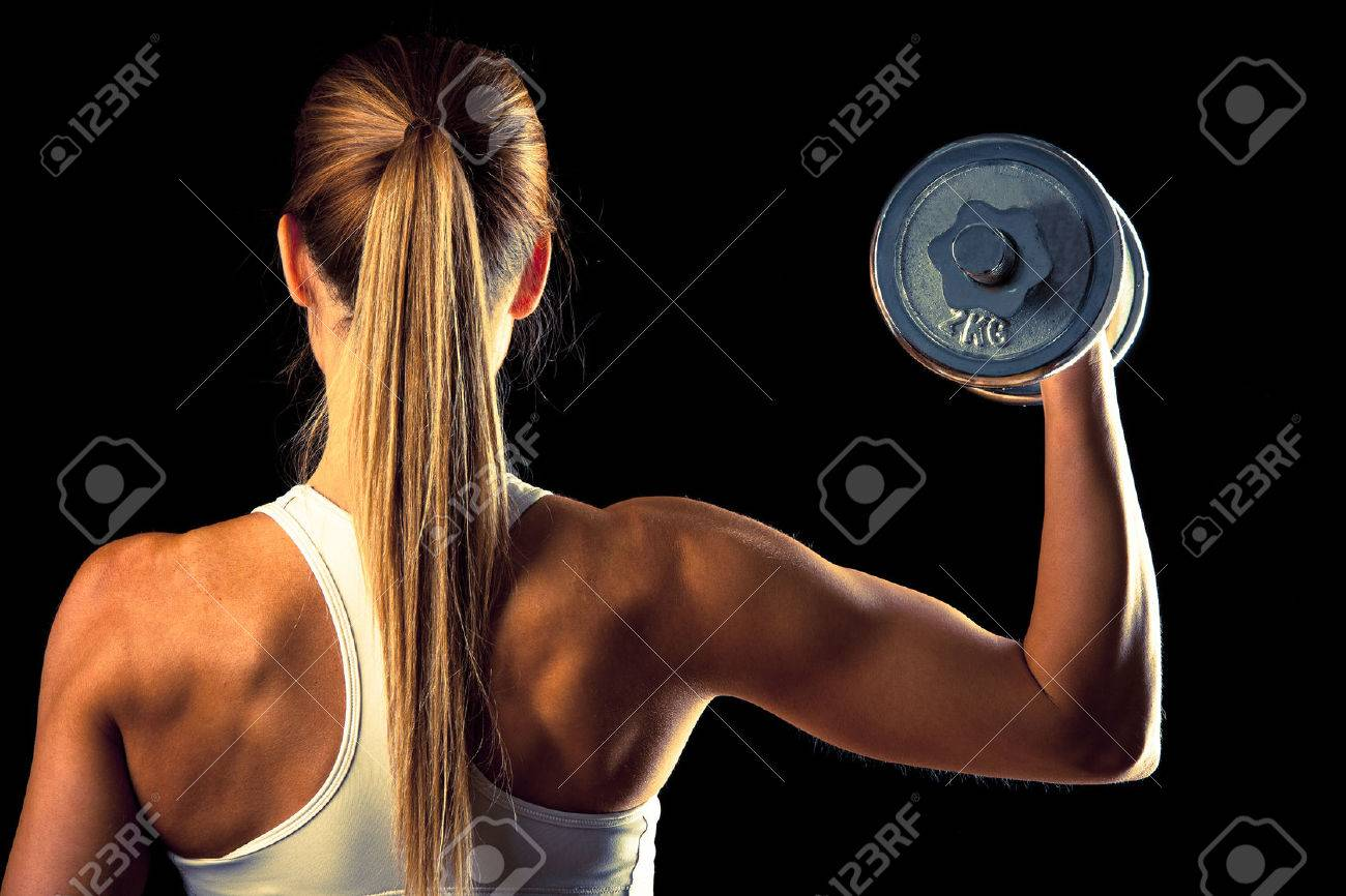 attractive young woman working out with dumbbells Stock Photo - 26494327