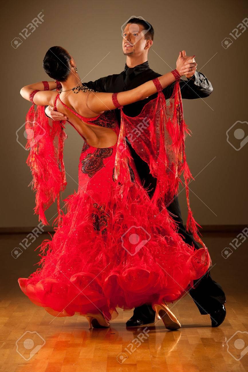Professional ballroom dance couple preform an romantic exhibition dance Stock Photo - 27540470