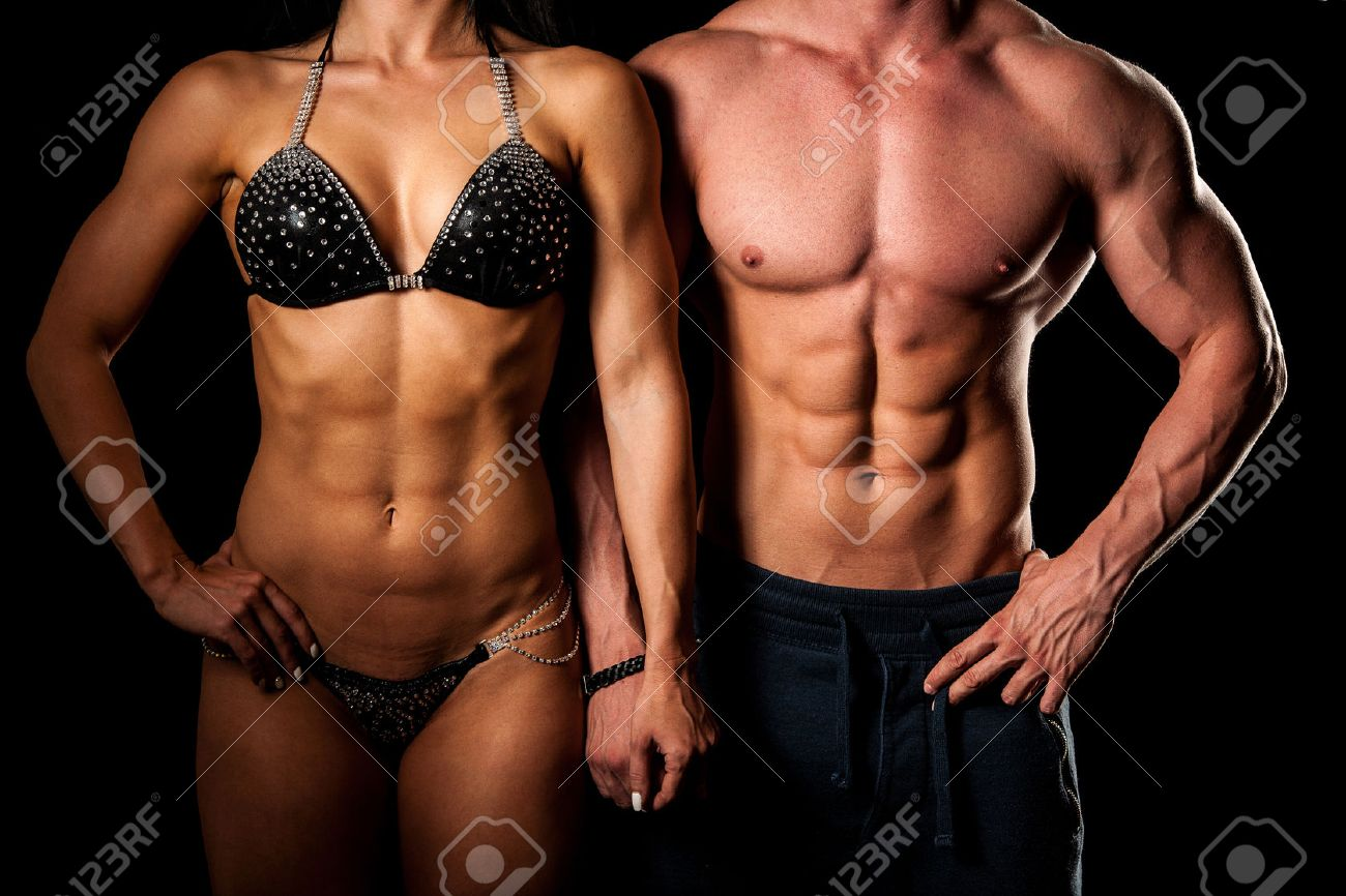 Fitness couple poses in studio - fit man and woman Stock Photo - 40887018
