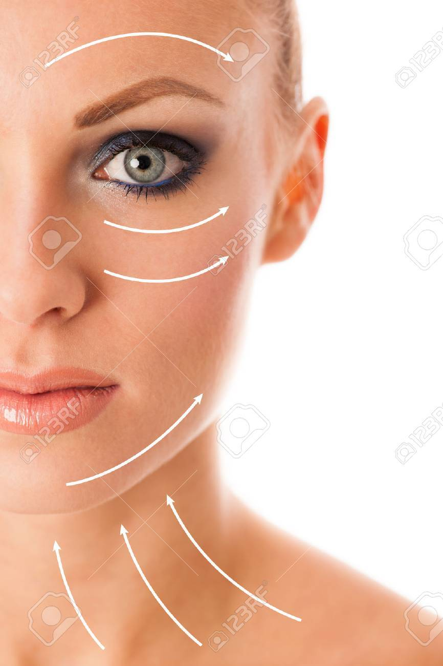 Beauty portrait of woman with perfect makeup, smokey eyes, full lips thinking about anti-aging facial surgery. Stock Photo - 53689883