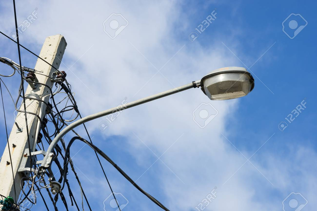 Street Light With Messy Electrical Wires And Cloudy Sky Stock Photo Wiring Lightfixture