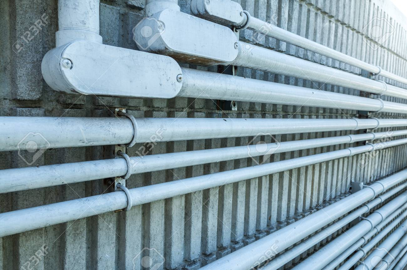 Electrical Conduit On Concrete Wall In Cold Tone Picture Stock Photo Wiring Behind Walls 106288212