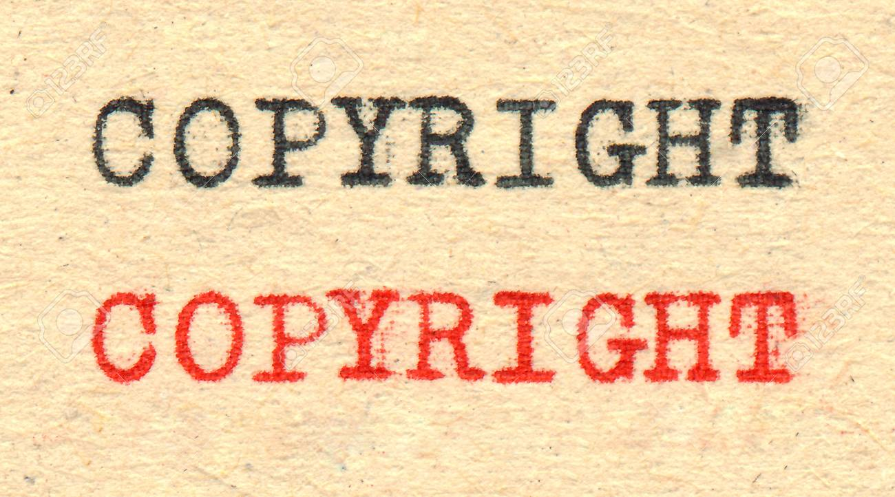 Copyright written by a typewriter on old paper Stock Photo - 18655707