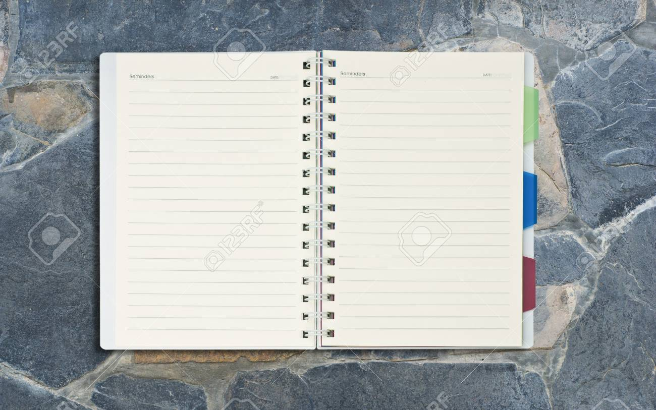 open blank notepad on cement background. Stock Photo - 10035184