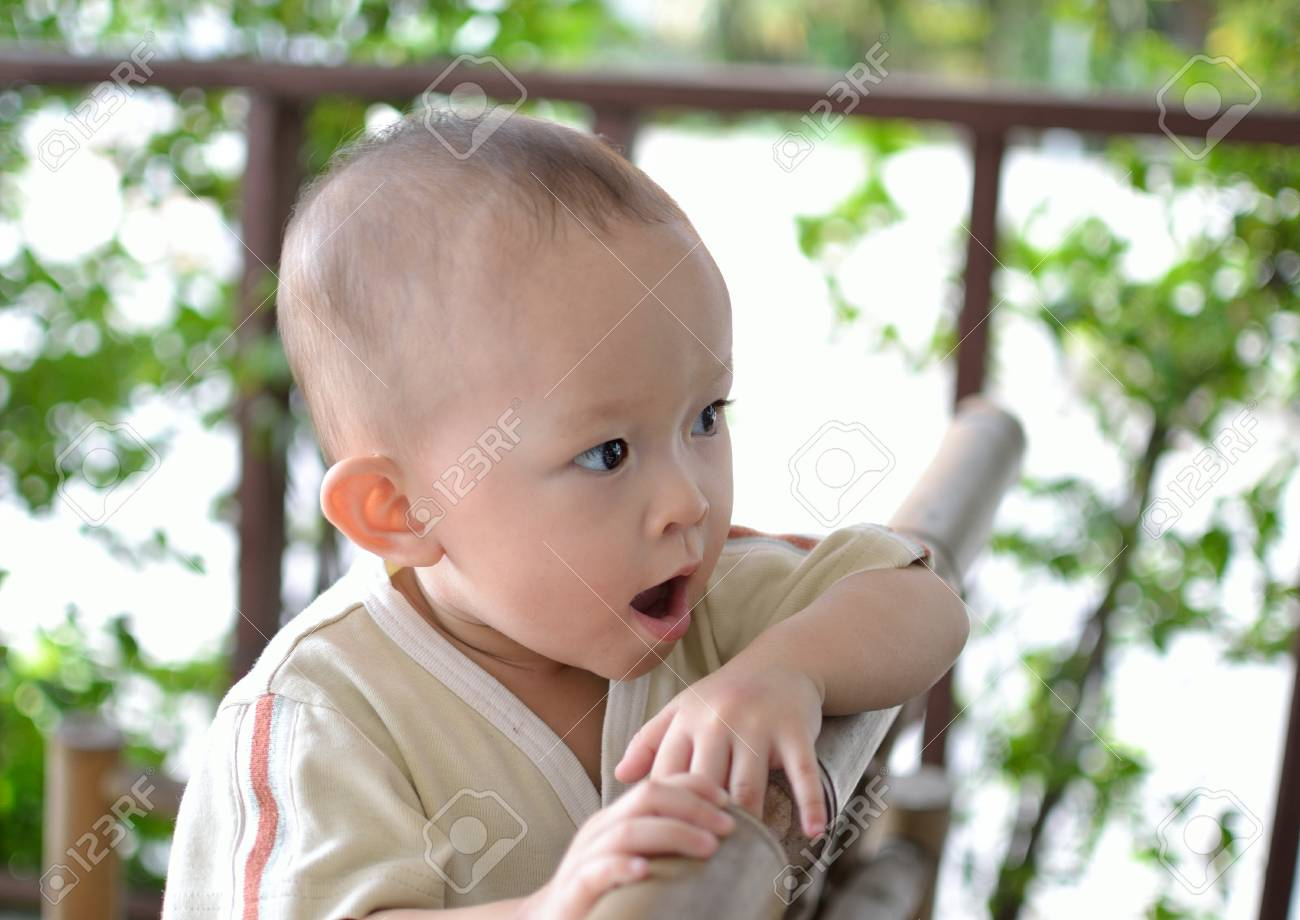 a cute young asian baby in daily activity. Stock Photo - 10058493