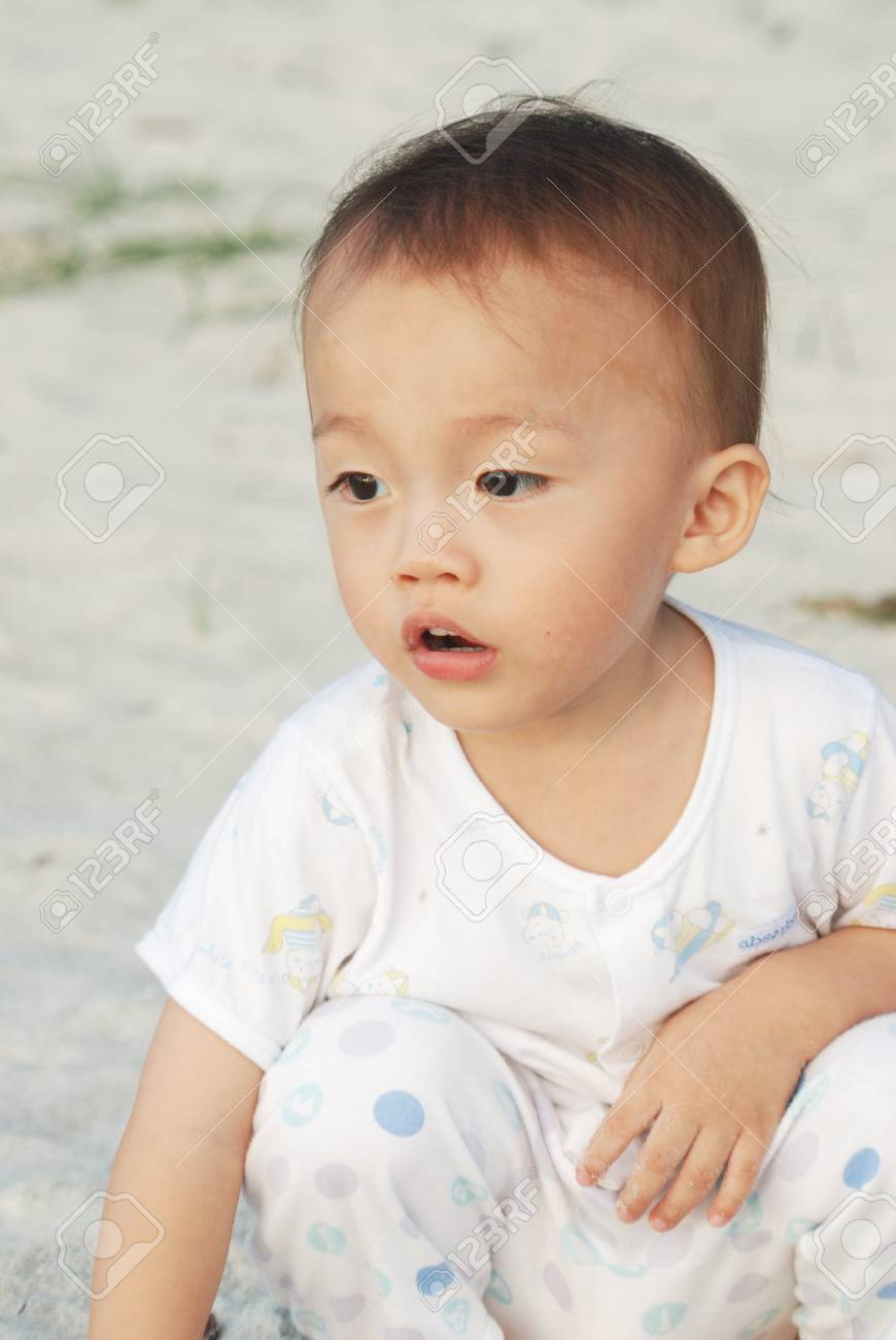 almost two year old asian boy with activity in playground. Stock Photo - 10058532