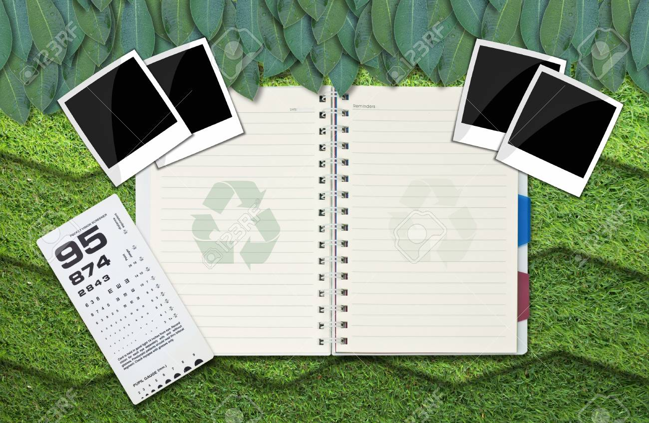 single blank notepad on attractive grass background. Stock Photo - 10587066