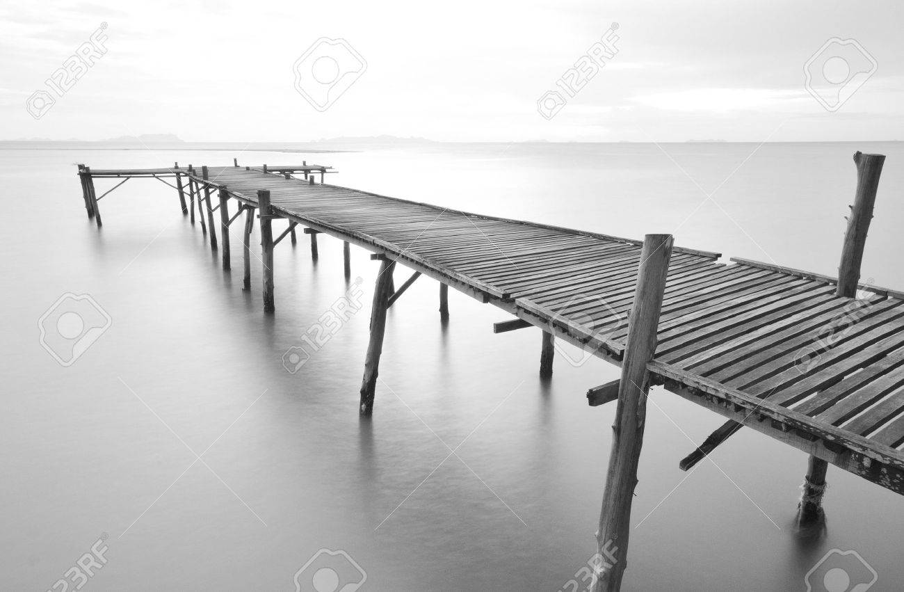 balck and white picture of old bridge to the sea. Stock Photo - 12520853