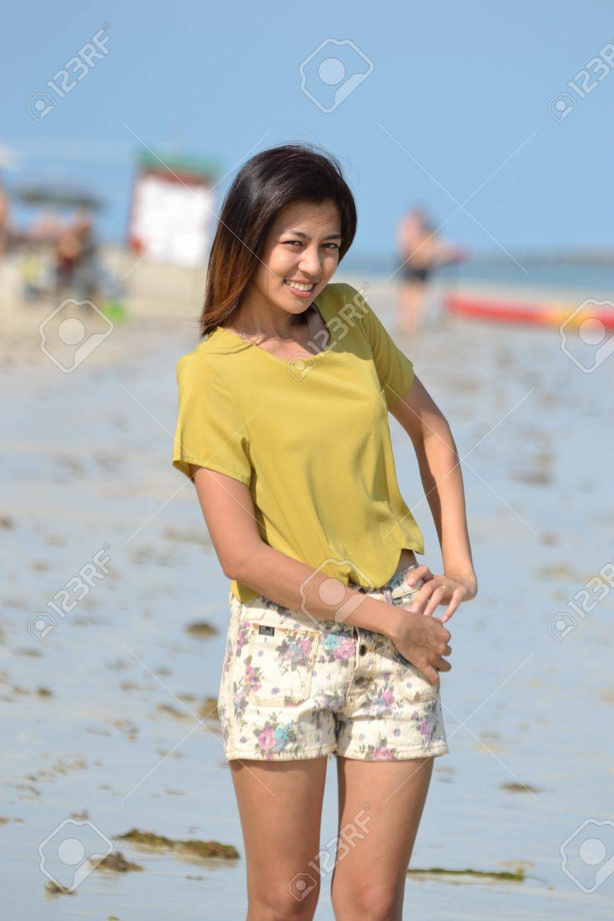 Cute young asian woman portrait outdoor scene. Stock Photo - 13197216