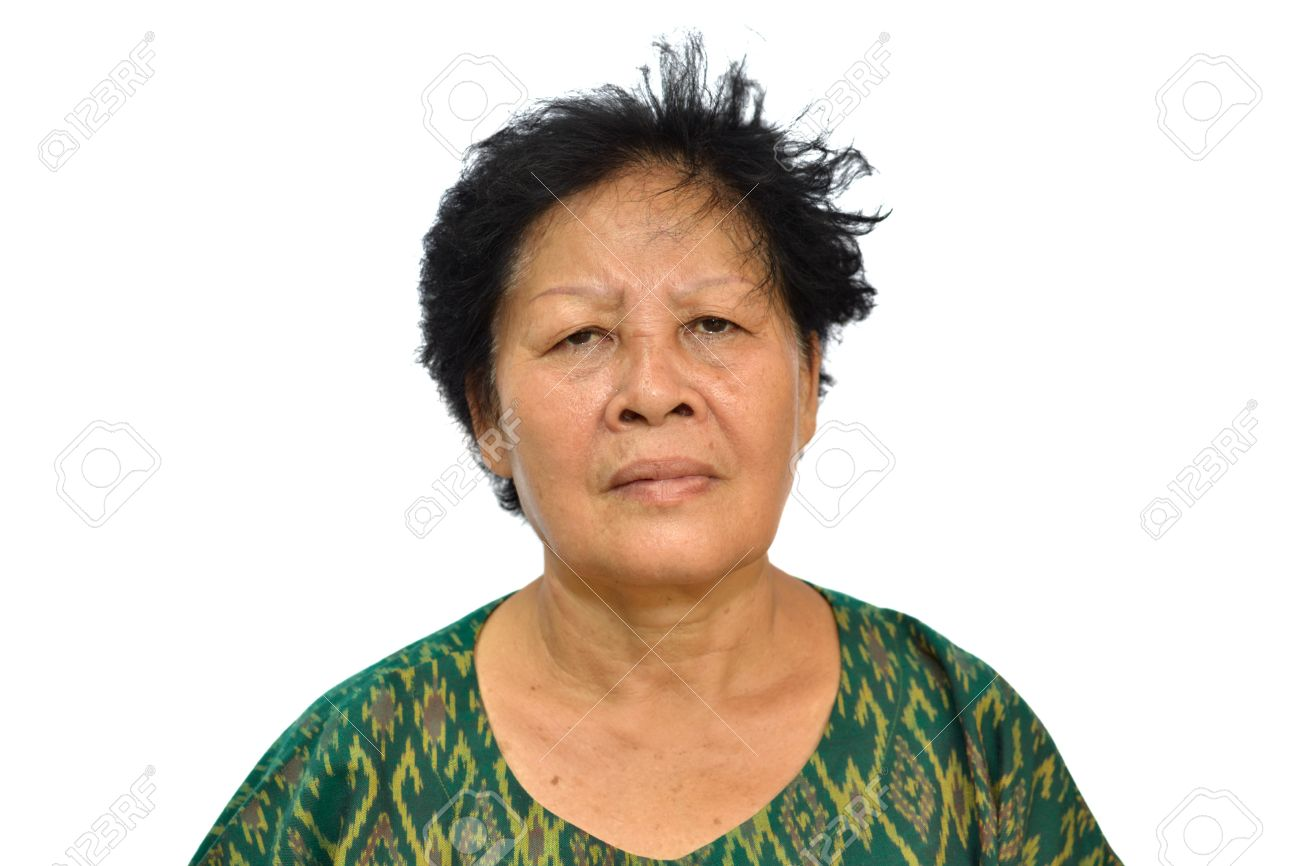 Portrait of and old asian woman on white background. Stock Photo - 13259544