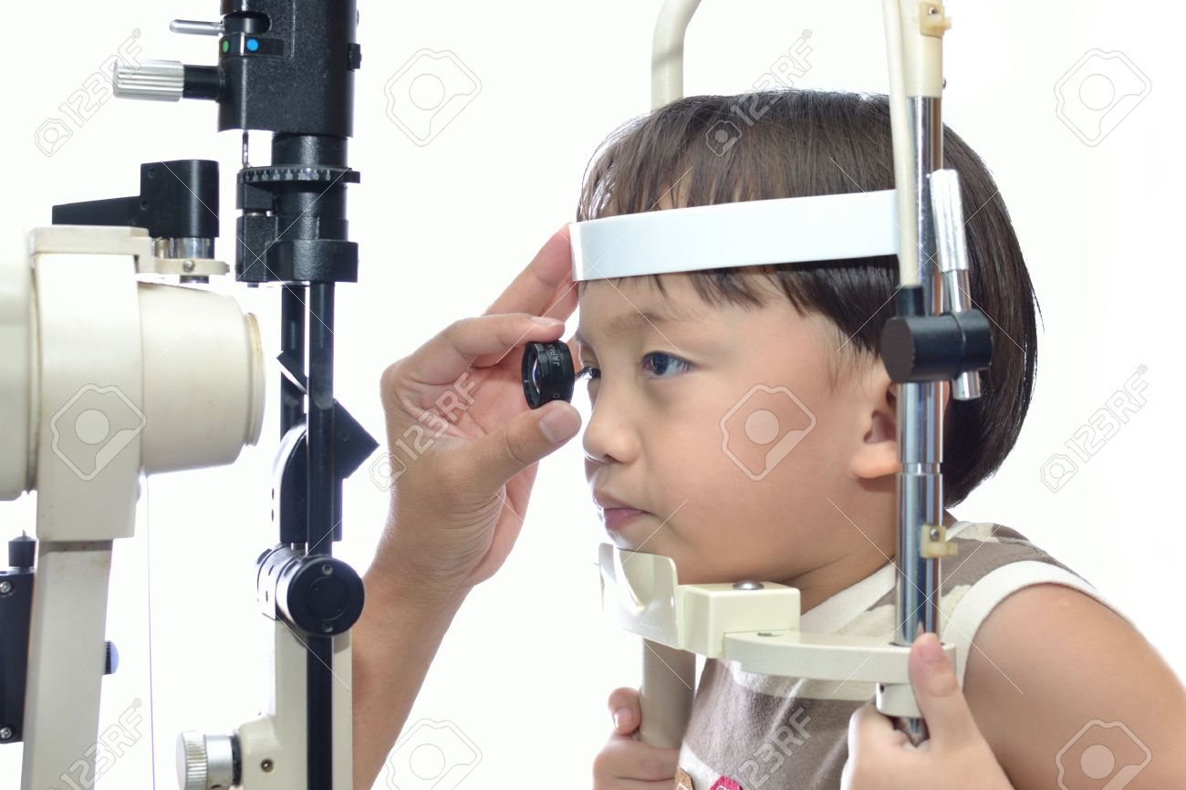 Small boy with slit lamp microscope for eye examination. Stock Photo - 13259239