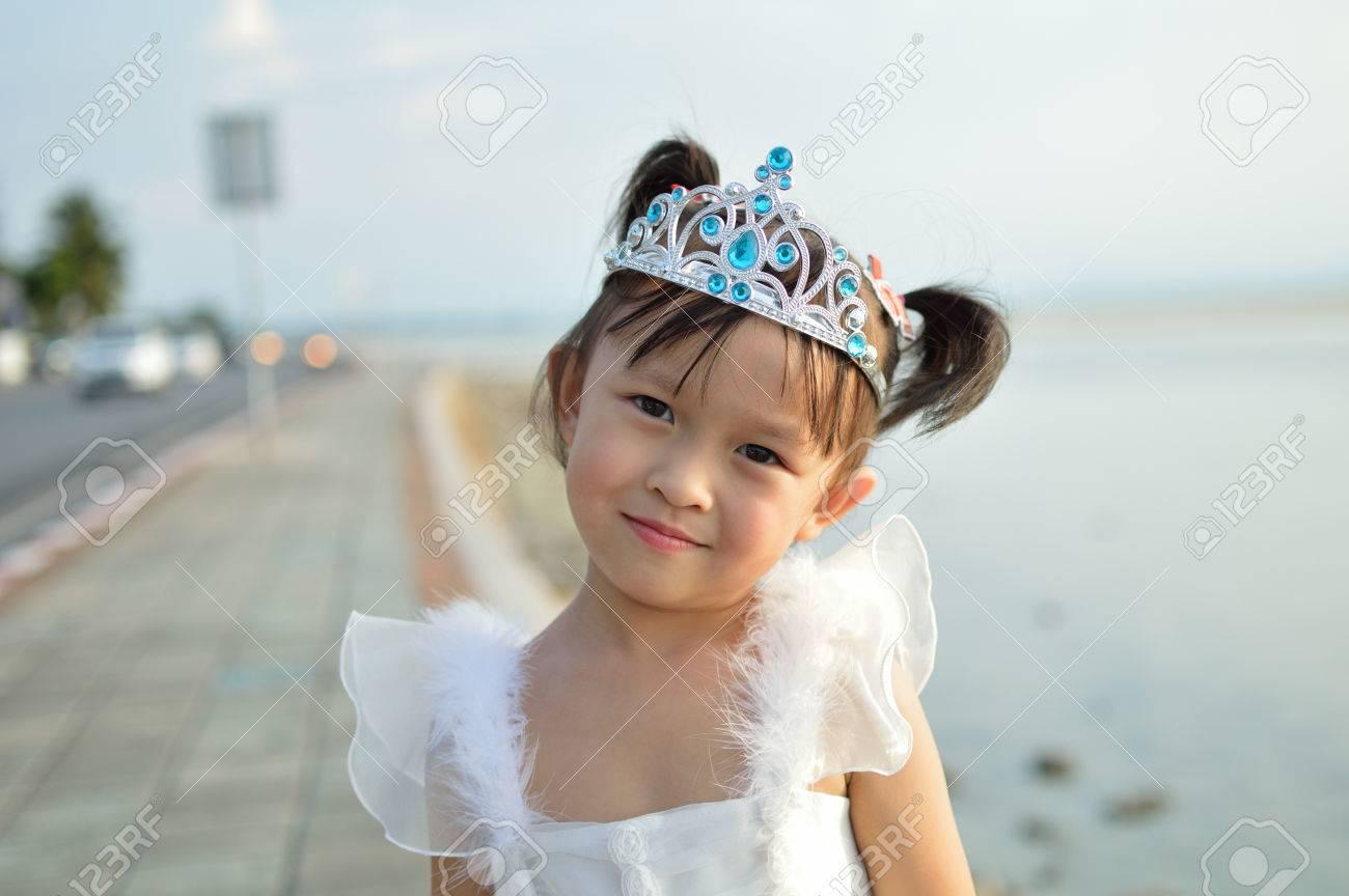 Cute asian small girl in fancy dress outdoor scene. Stock Photo - 47745368