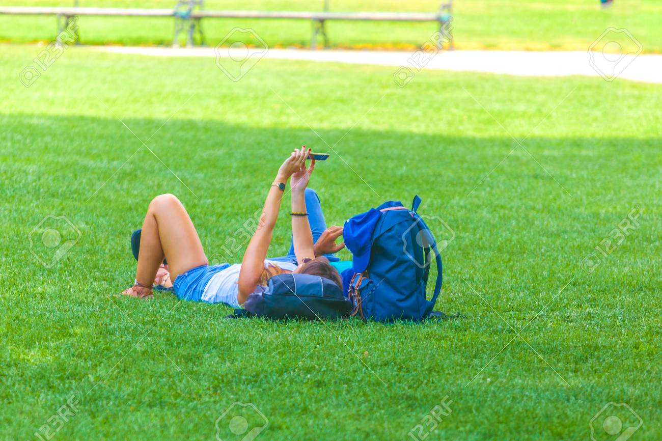 people are relaxing in public city park in Vienna, Austria. - 114168996