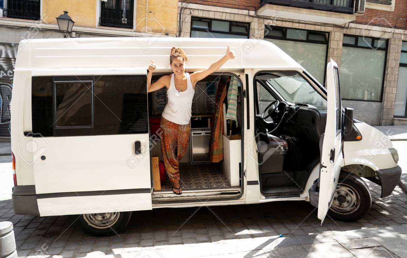 Happy Beautiful Yong Woman Traveling By Camper Van Around Europe