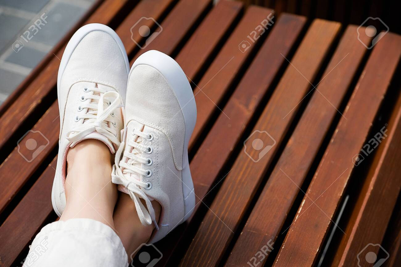 Terrific The Girls Legs In New White Sneakers And Jeans A Woman In Sports Machost Co Dining Chair Design Ideas Machostcouk