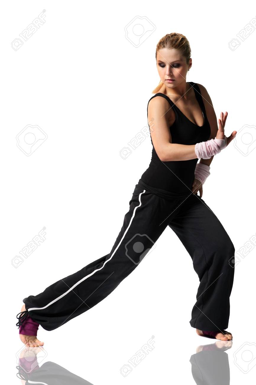 giyoung female in black clothes doing fitness exersize and dancing Stock Photo - 3029722