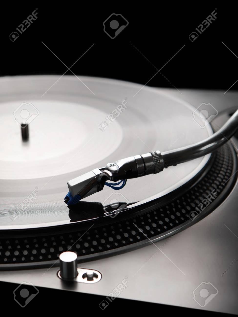 Macro shot of vinyl player with backlight Stock Photo - 3038902