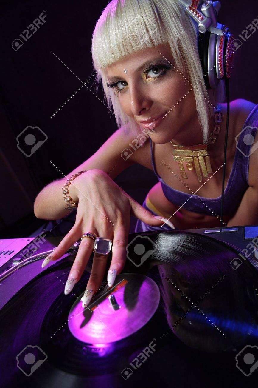 beautiful girl dj playong on vinyl player Stock Photo - 3202447