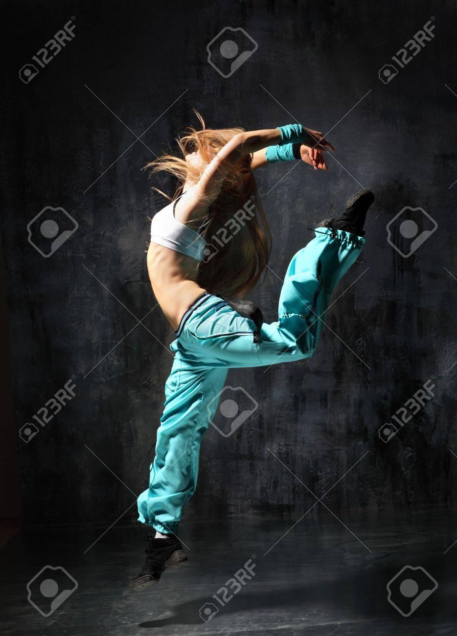 modern style dancer posing behind studio background - 4659460
