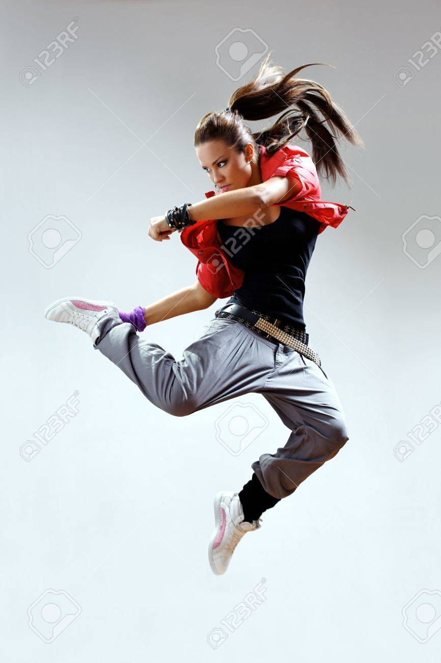 modern dancer poses in front of the gray wall Stock Photo - 5826686