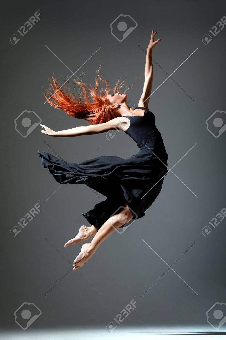 young beautiful dancer posing on a studio background Stock Photo - 14199081