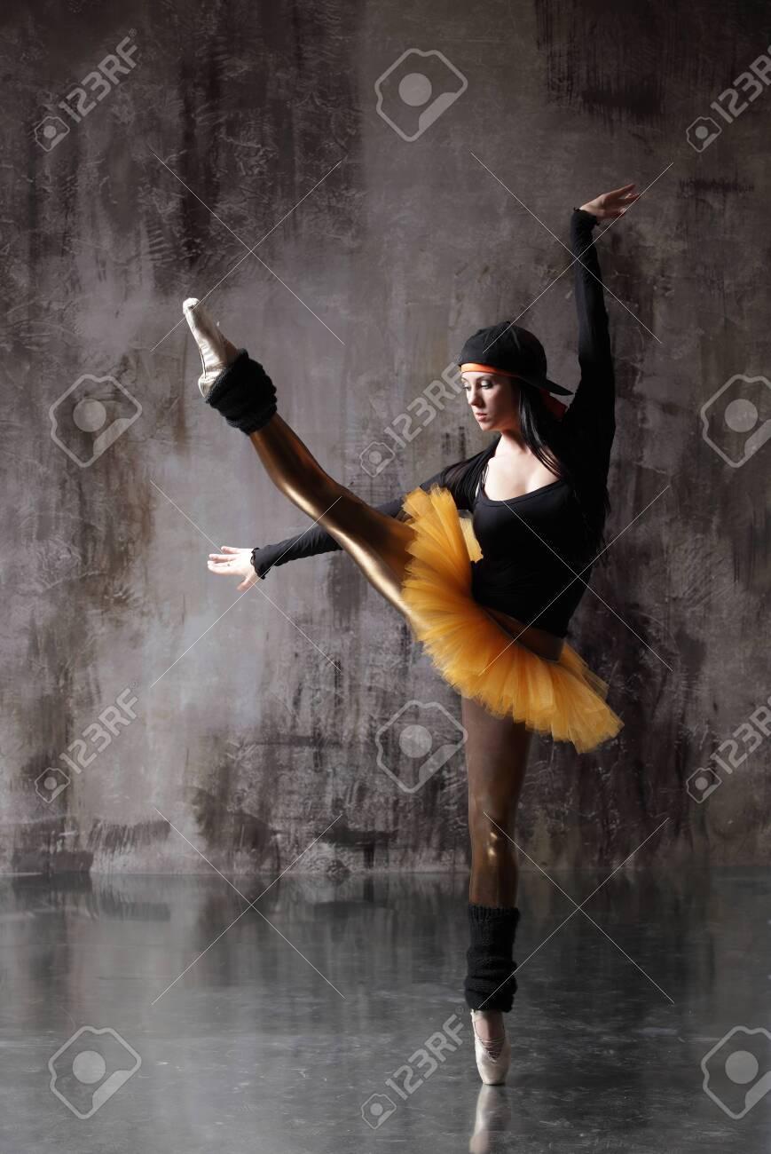 Young beautiful ballerina is posing in studio - 145066244