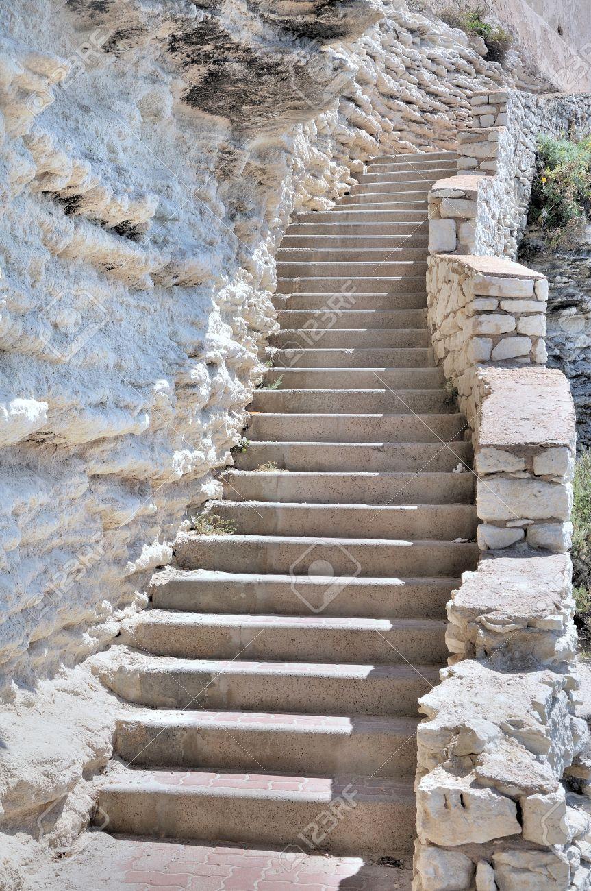 https://previews.123rf.com/images/sanddebeautheil/sanddebeautheil1108/sanddebeautheil110800027/10286769-many-steps-of-a-staircase-along-a-limestone-cliff.jpg