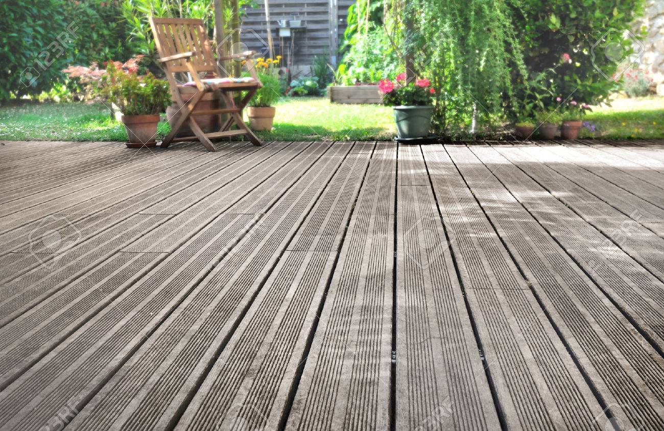 Slats Of A Wooden Terrace Overlooking Garden Stock Photo   50938488