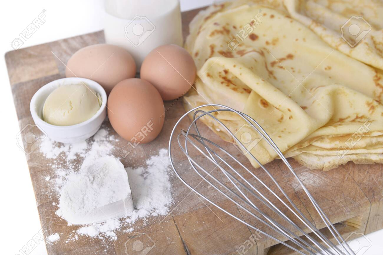 homemade french pancakes with ingredient and heart shaped in the flour on a plank - 119266616