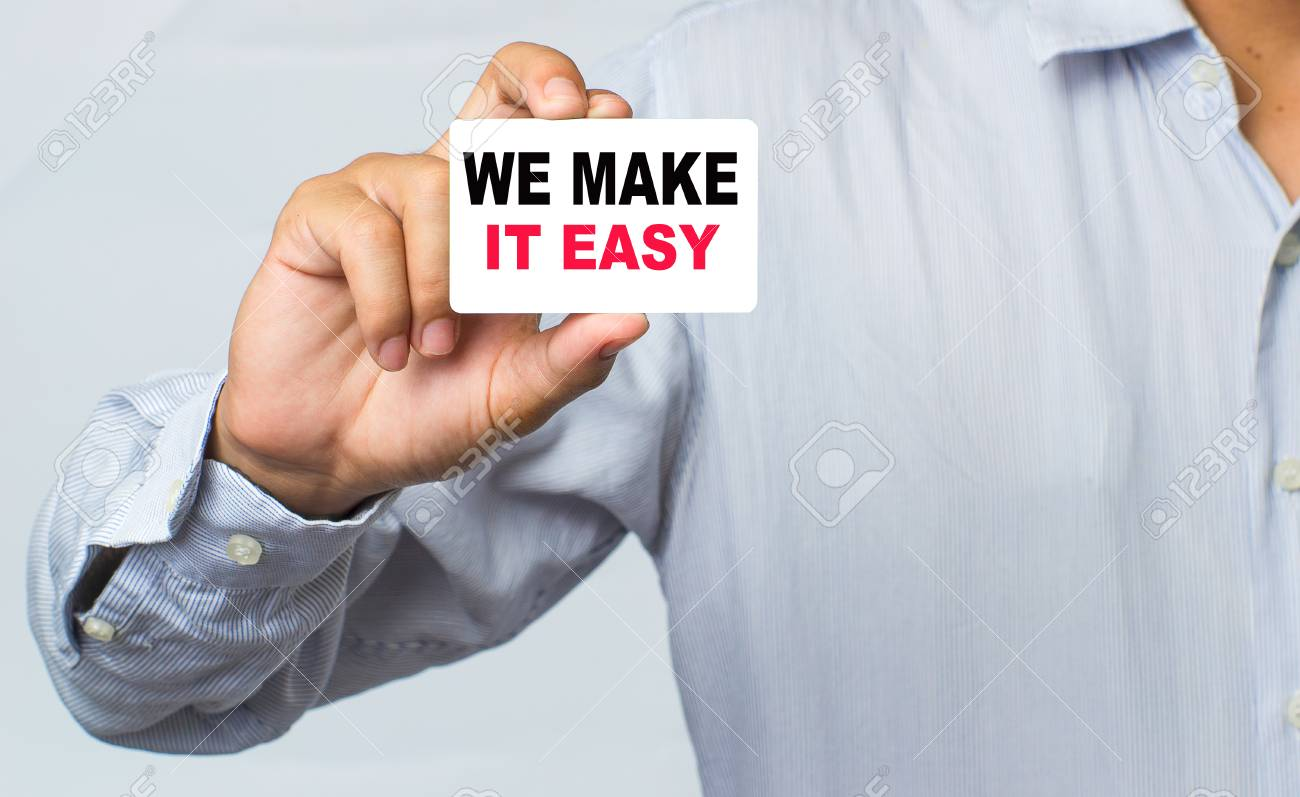 Businessman showing business card with we make it easy message businessman showing business card with we make it easy message on the card shown by a reheart Gallery