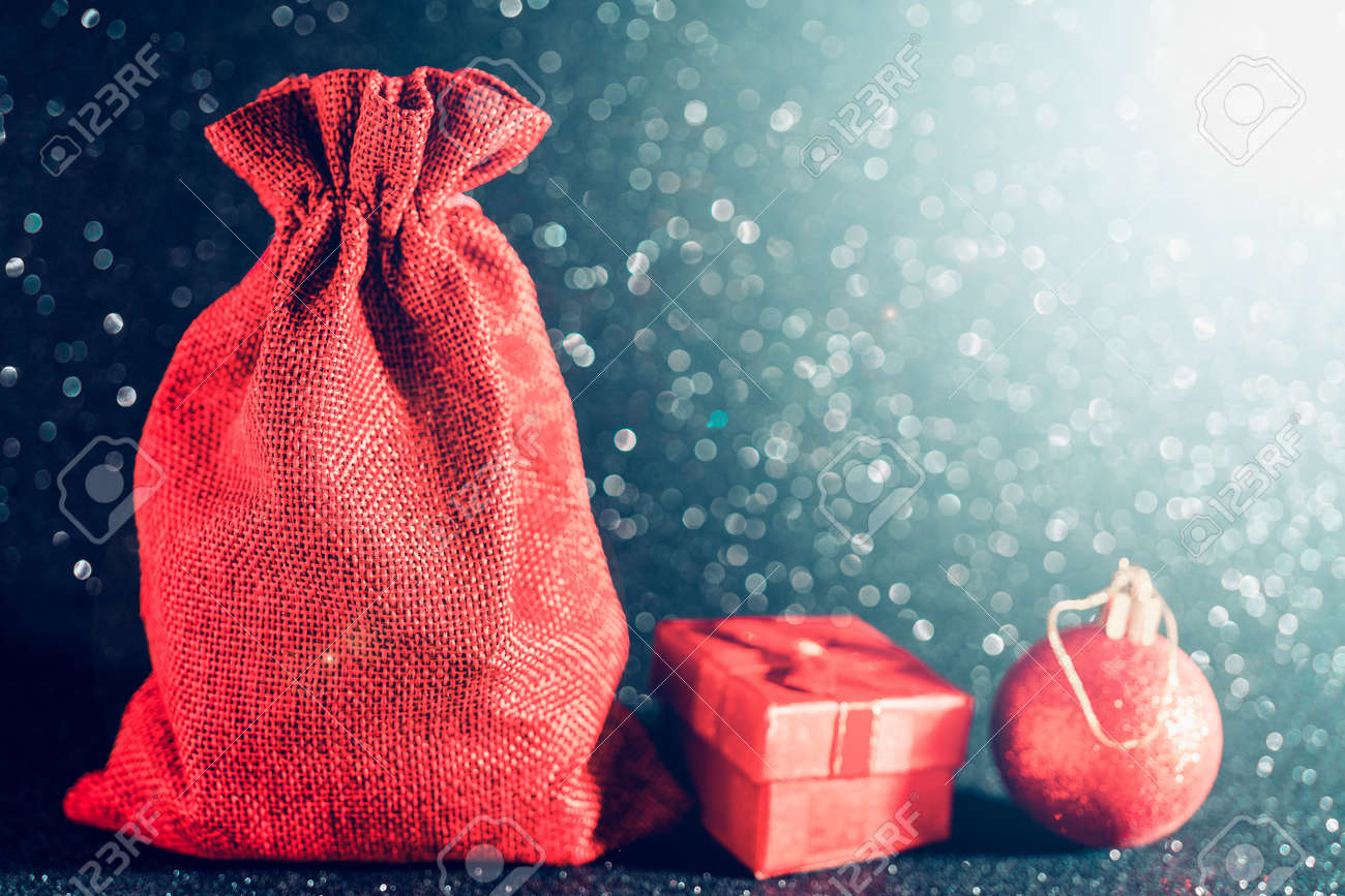 Christmas shiny black background. Red gift bag and Christmas toys. - 133288664
