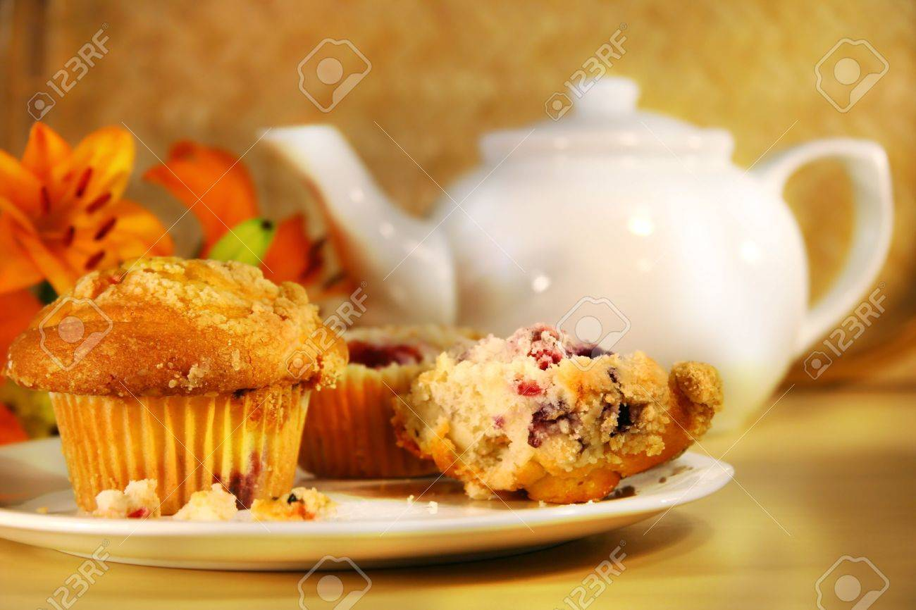 Healthy breakfast with cranberry muffins, tea and orange juice on bamboo mat Stock Photo - 2575315