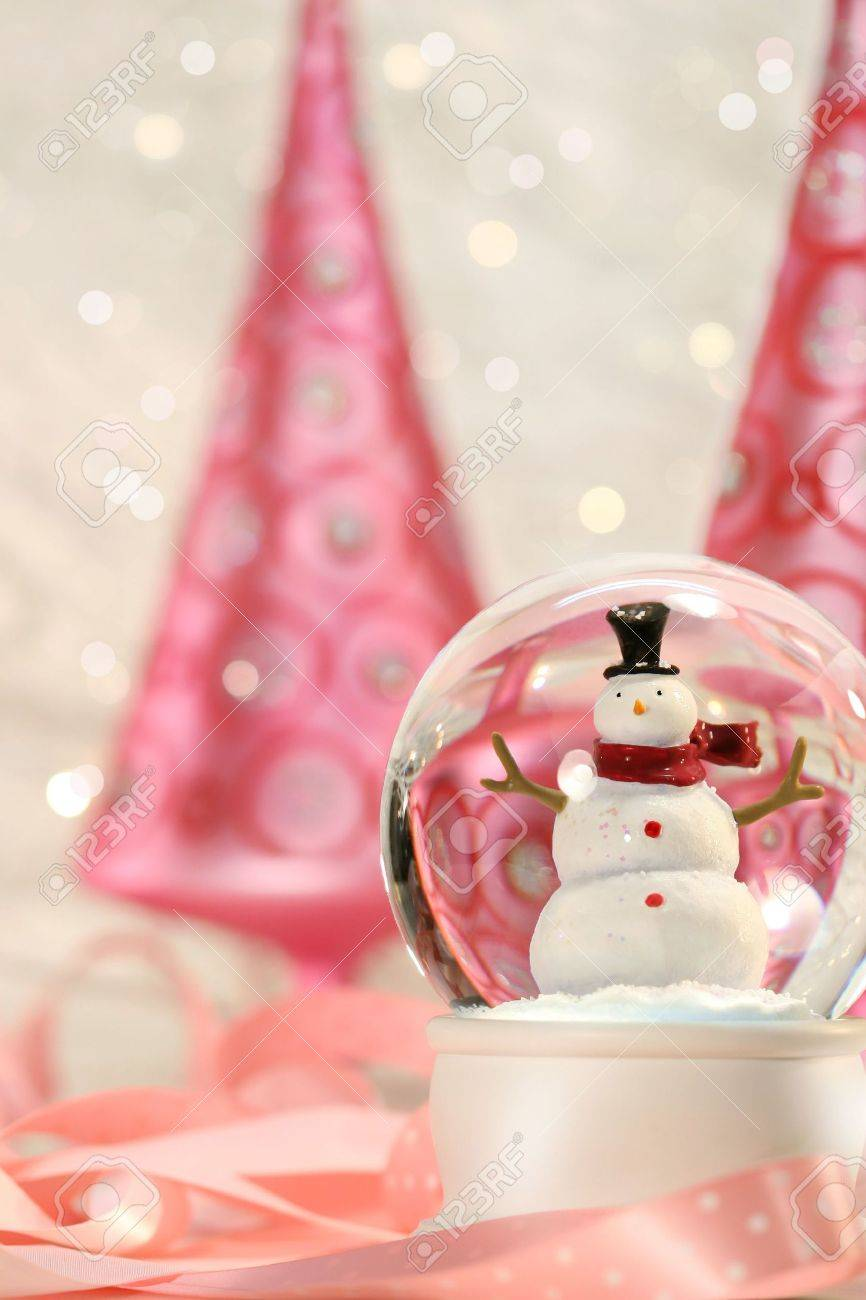 Pink Christmas Trees.Snow Globe With Pink Christmas Trees In A Winter White Background
