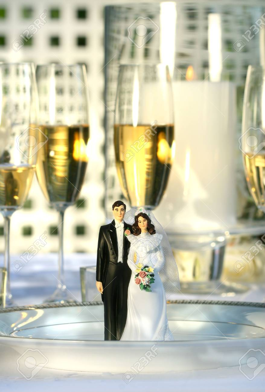 Wedding cake figurines on plate at dinner reception Stock Photo - 3280144