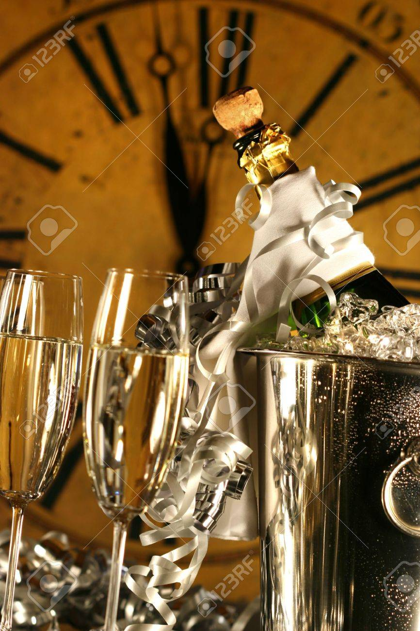 Champagne in bucket with glasses ready for New Years festivities Stock Photo - 3899311