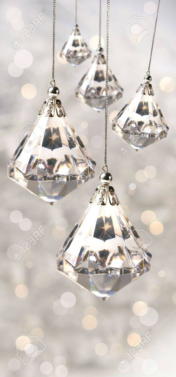 Crystal Christmas Ornaments.Crystal Christmas Ornaments Against Festive Silver Background